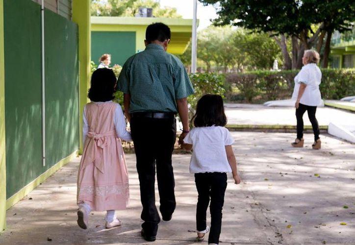Imagen de los menores en proceso de adopción, quienes pasarán la Navidad en familia. (Milenio Novedades)