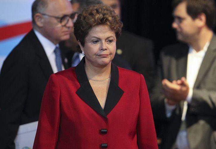 Tras la bonanza económica de Brasil en los últimos años, la presidenta Dilma Rousseff asumirá de nuevo el mando con algunas dificultades. (EFE/Archivo)