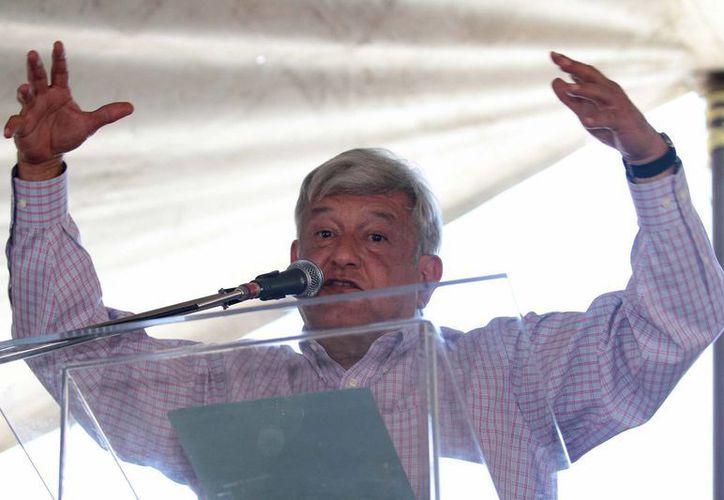 AMLO asegura que el gobierno federal pretende minimizar sus movilizaciones. (Archivo/Notimex)