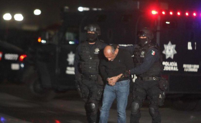 Ya fue consignado 'La Tuta', a quien muchos pensaban que sería capturado en alguna cueva, pero el arresto ocurrió en una colonia popular de Morelia, Michoacán. (Notimex)