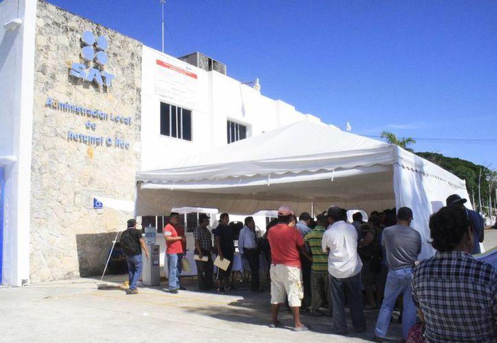 El SAT reporta en Chetumal la realización de hasta 400 servicios diarios. (Harold Alcocer/SIPSE)