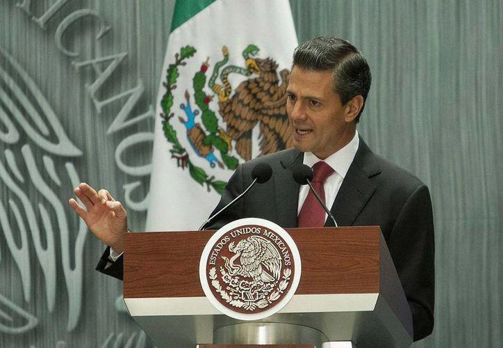 Enrique Peña Nieto se ubica en séptimo lugar y cierra la lista de mandatarios con evaluación alta en América Latina. (Imagen de archivo/Notimex)