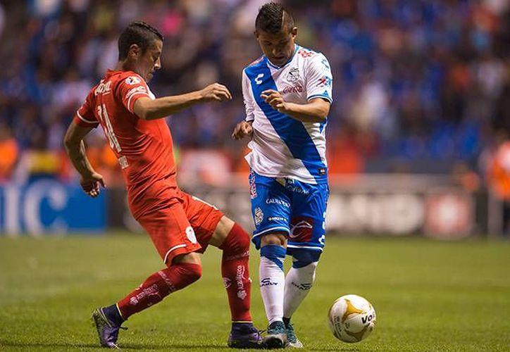 Toluca ganaba 2-0 pero Puebla, que era local, igualó 2-2 y así terminó este partido de cuartos de final de Liguilla del Futbol Mexicano. (mexsport.com)