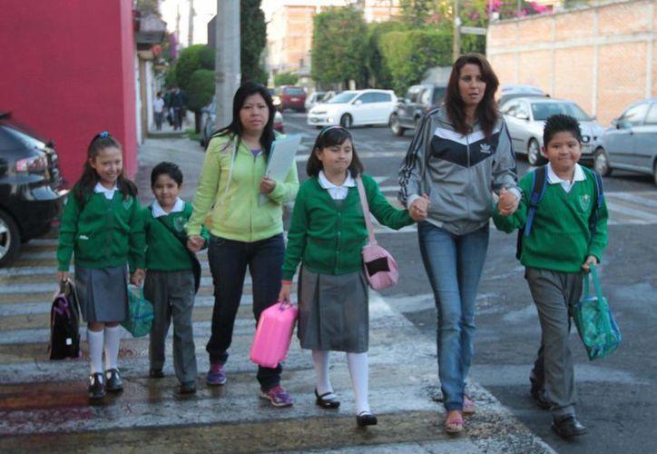 Es posible que en algunas escuelas haya clases el día 15 de septiembre. (Archivo/Notimex)