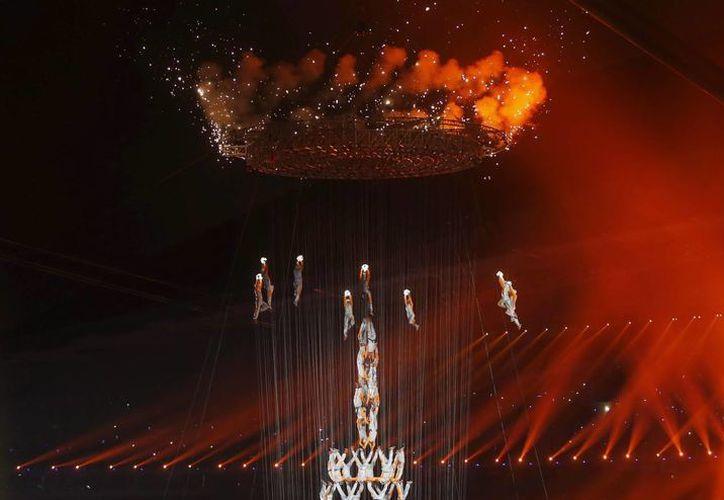 En la apertura de los Juegos Olímpicos de la Juventud, en Nanking, China, participaron 4,000 bailarines y actores. (EFE)