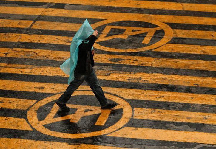 La noche de este martes y las primeras horas del miércoles prevalecerán las condiciones de lluvia. (Notimex)
