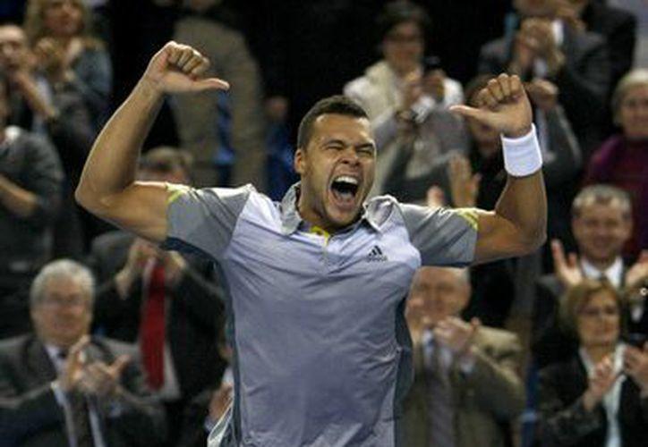 Tsonga al momento de vencer a Berdych para conquistar su primer título del año. (Agencias)