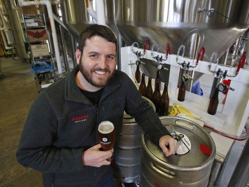 Pulitzer Prize winning photojournalist, Ryan Kelly, poses in the brewery at his new job at Ardent Craft Ales in Richmond, Va.