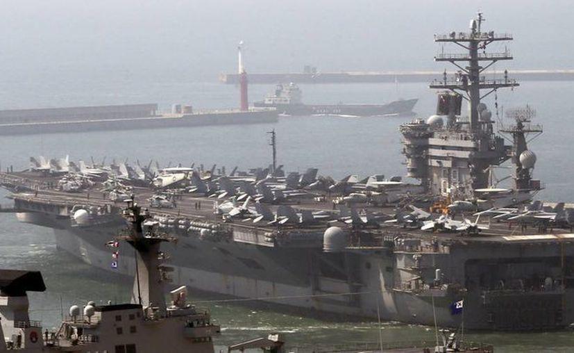 Pasan de 11 a 8 los portaviones y reducen de 182, 000 a 150,000 el Cuerpo de Marines. (Archivo EFE)