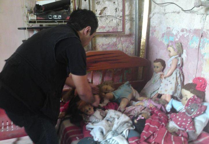 Aseguran que almas en pena de niños se apoderaron de estas muñecas y muñecos. (Jorge Moreno/SIPSE)