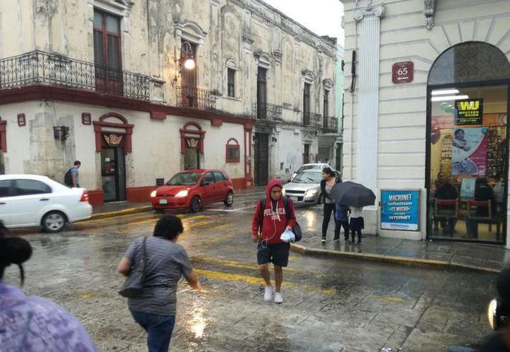 Este día, una vaguada sobre el centro de la Península de Yucatán favorecerá la presencia de lluvias. (SIPSE)