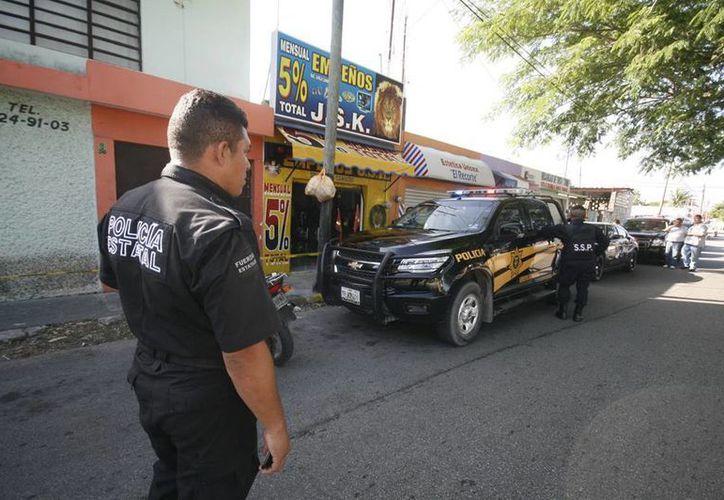 Agentes de la SSP capturaron a los ladrones de la casa de empeños. (Jorge Sosa/SIPSE)