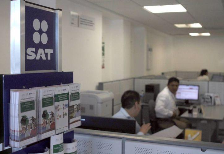 El SAT se encarga de realizar la devolución del impuesto. (Israel Leal/SIPSE)