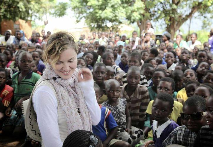 Madonna llegó a Malaui para visitar 10 escuelas que ha ayudado a construir. (Agencias)