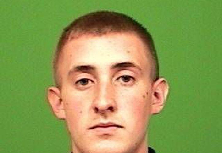 El agente Brian Moore fue baleado en la cabeza mientras trataba de detener a un sospechoso. (Agencias)