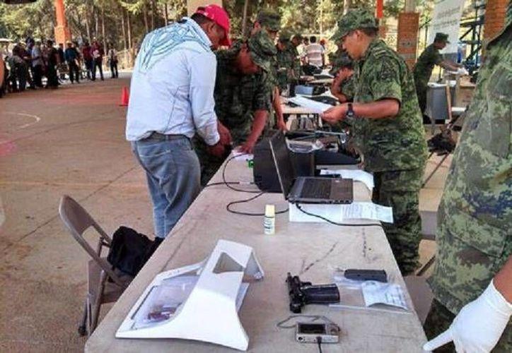 """""""Armas pesadas"""" como las calibre 50, ametralladoras M60 y lanza cohetes sí serán decomisadas. (Milenio)"""