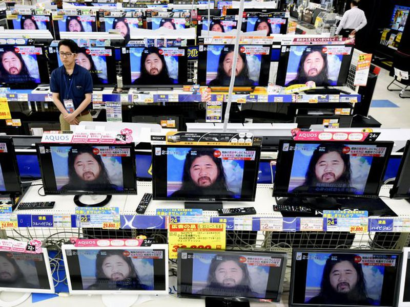 TV screens at an electrical appliance store show the image of doomsday cult leader Shoko Asahara. (AP)