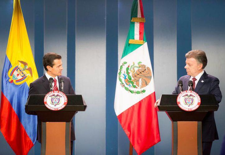 'México forma parte de la misión especial de la ONU y de la iniciativa para el desminado en el país', dijo el mandatario colombiano Juan Manuel Santos tras anunciar la ayuda de México. (Notimex)