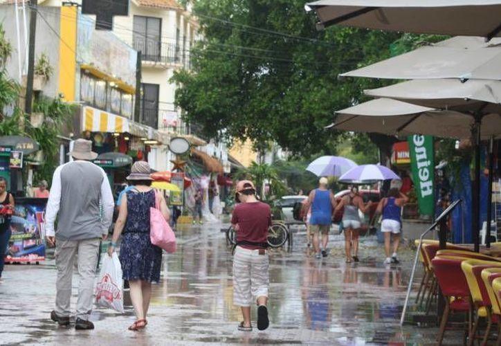 Debido a las lluvias provocadas por la onda tropical número 25, la CAPA implementa operativos con el fin de evitar inundaciones en Playa del Carmen y Chetumal.  (Archivo/SIPSE)