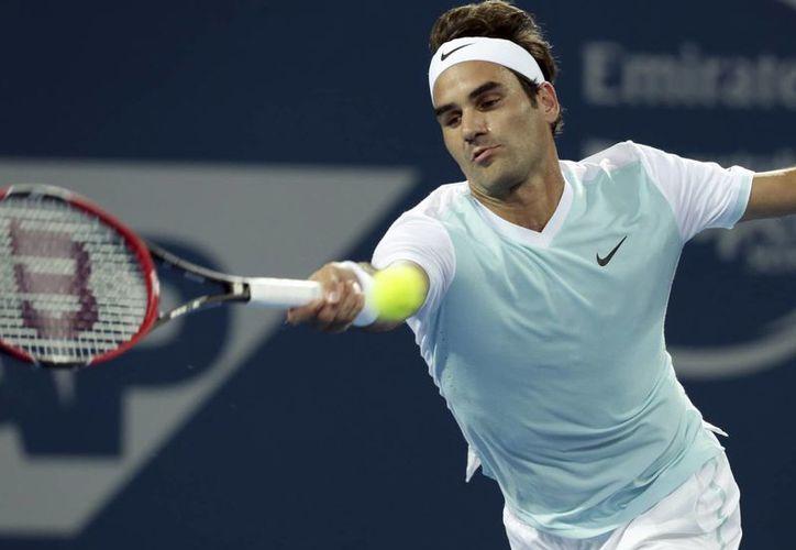 Roger Federer empleó 55 minutos para despachar al alemán Tobias Kamke de 6-2 y 6-1 en el Torneo Internacional de Brisbane. (AP)