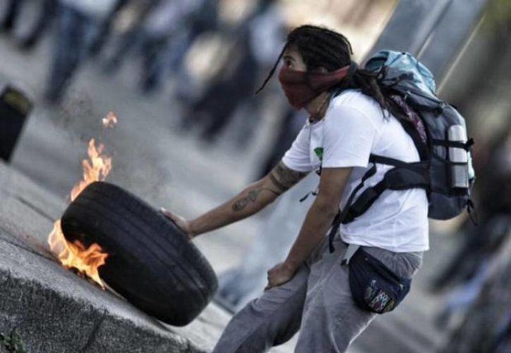 Otras personas manifestaron que los retenidos guardan relación con grupos anarcos. (Foto de contexto/terra.com.mx)