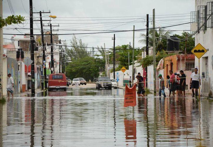 Así lucieron algunas de las inundaciones más notables de Cancún. (Victoria González/SIPSE)