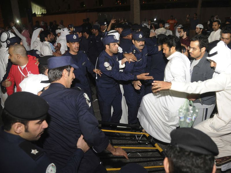 Dozens of Kuwaitis briefly storm Kuwait's parliament building as hundreds of others protested outside in Kuwait City, Kuwait.