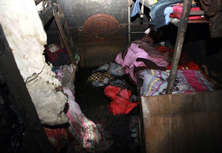 Una mujer utilizaba el lugar como refugio para los niños desamparados. (Agencias)