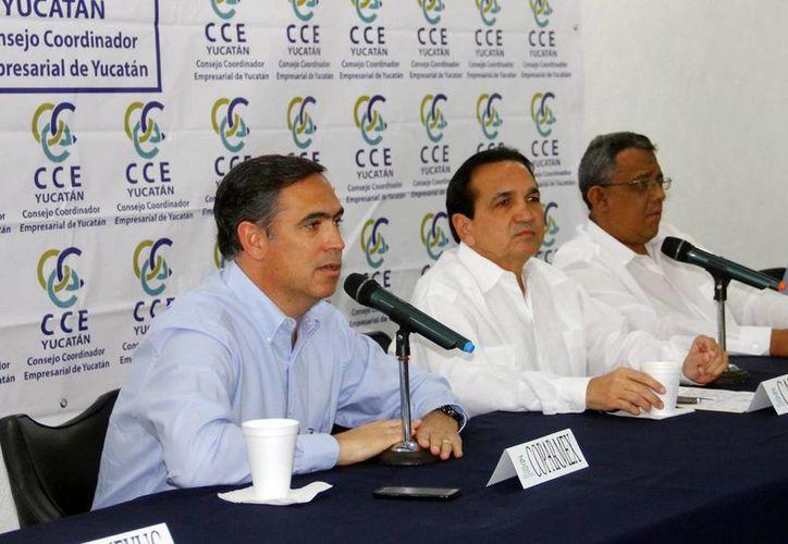 Nicolás Madáhuar Boehm, José Manuel López Campos y Mario Can Marín hablaron sobre cómo afectará la fuga de 'El Chapo' Guzmán a la economía nacional. (Milenio Novedades)