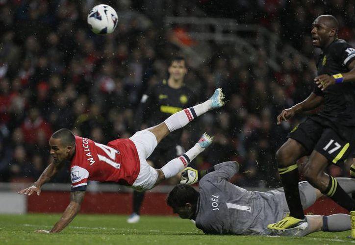 El Wigan perdió ante un Arsenal que tuvo un desastroso inicio de temporada. (Agencias).
