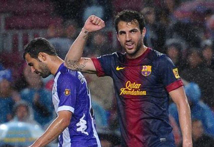 Cesc Fábregas, del Barcelona, luego de que su equipo anotó un gol ante Valladolid. (Agencias)