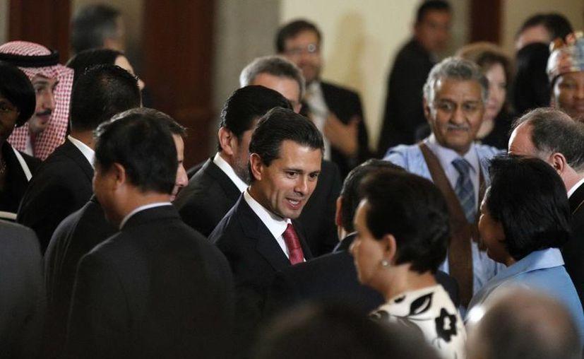 """El presidente de México, Enrique Peña Nieto encabezó la """"Reunión con Cuerpo Diplomático"""" en el Palacio Nacional. (Notimex)"""