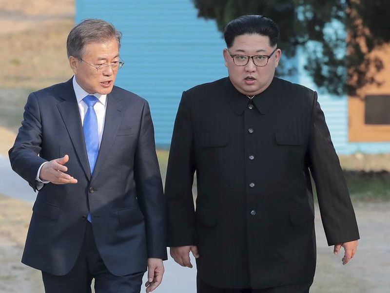 North Korean leader Kim Jong Un speaks with South Korean President Moon Jae-in at Peace House of the border village of Panmunjom in the Demilitarized Zone, South Korea.