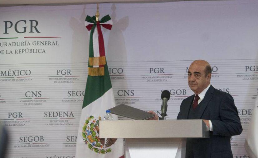 El procurador Murillo Karam dice que los peritajes de los expertos argentinos y los de la PGR son coincidentes. (Imagen de Archivo/Notimex)