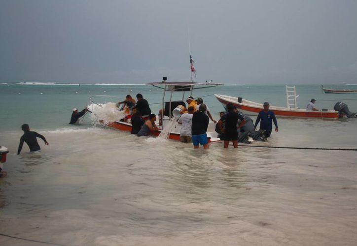 Los daños causados a las lanchas que fueron inundadas aún no se han cuantificado. (Rossy López/SIPSE)