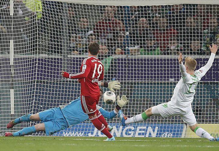 Mario Goetze (foto) y Thomas Mueller fueron los responsables de los goles anotados en la portería del Borussia. (Agencias)