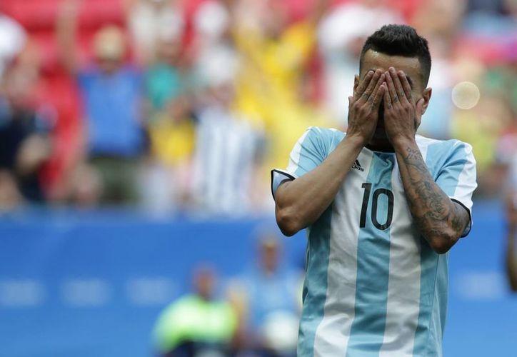 La selección de Argentina quedó eliminada del torneo olímpico, sumando 4 unidades y quedando por debajo de Portugal y Honduras.(Eraldo Peres/AP)