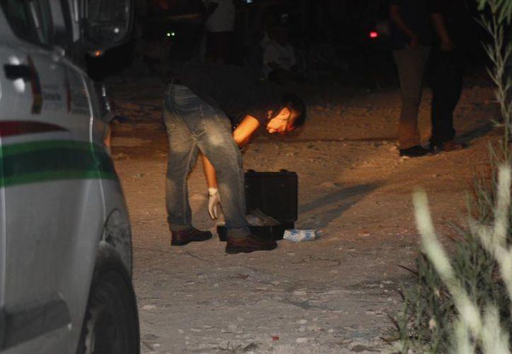 La Policía retiró un casquillo percutido 9 milímetros afuera de la vivienda de la región 211. (Redacción/SIPSE)