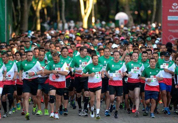 El presidente, Enrique Peña Nieto, participó en la Quinta Carrera Molino del Rey en el circuito atlético del Bosque de Chapultepec. (presidencia.gob.mx)