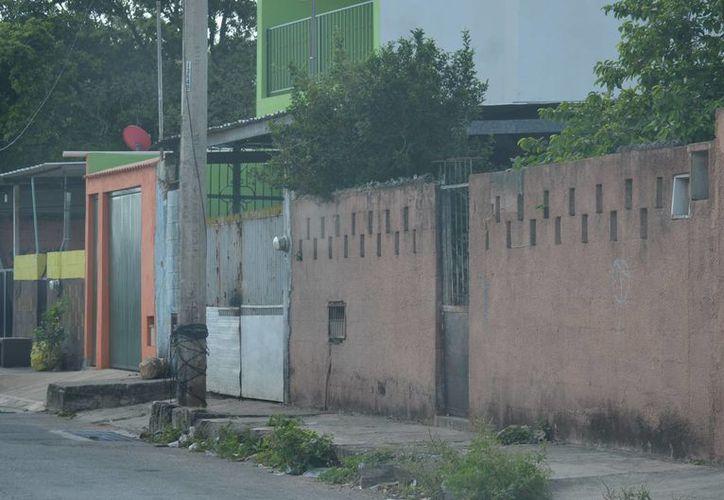 Fachada del predio de la colonia Emiliano Zapata Sur en el que cometió suicidio una mujer de 28 años. (Carlos Navarrete/SIPSE)