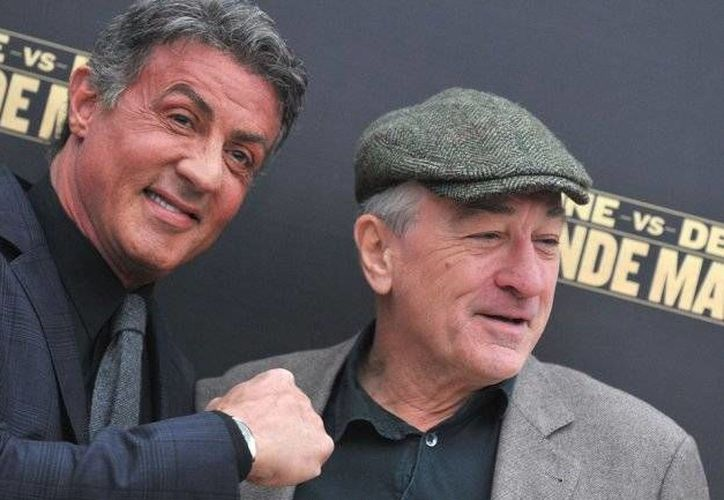 Stallone y De Niro se acompañan de Kim Basinger.(infobae.com/AFP)