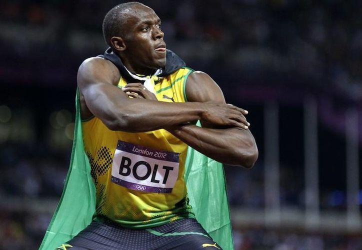 Usain Bolt tiene en su vitrina ocho oros tras sus históricas actuaciones en Pekín-2008 y Londres-2012. Espera aumentar los números en Río 2016. (Archivo AP)