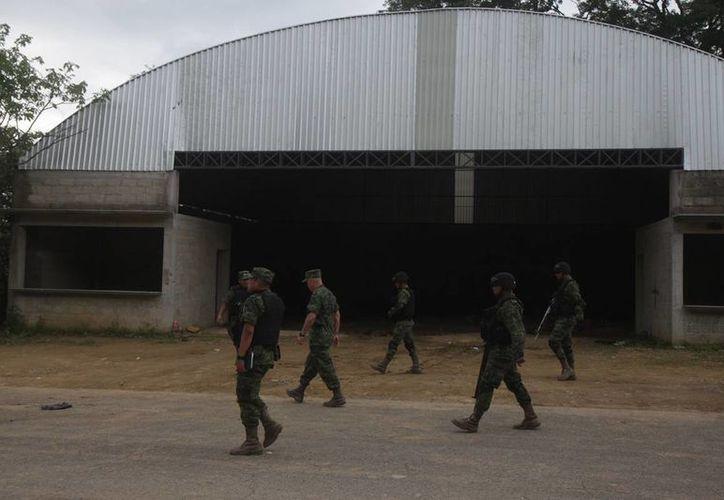 El 30 de junio de 2014 fallecieron 22 civiles, presuntos miembros de un grupo delictivo, durante un enfrentamiento con integrantes del Ejército. Imagen de archivo donde se encontraron los cuerpos de las víctimas. (Archivo/Agencias)