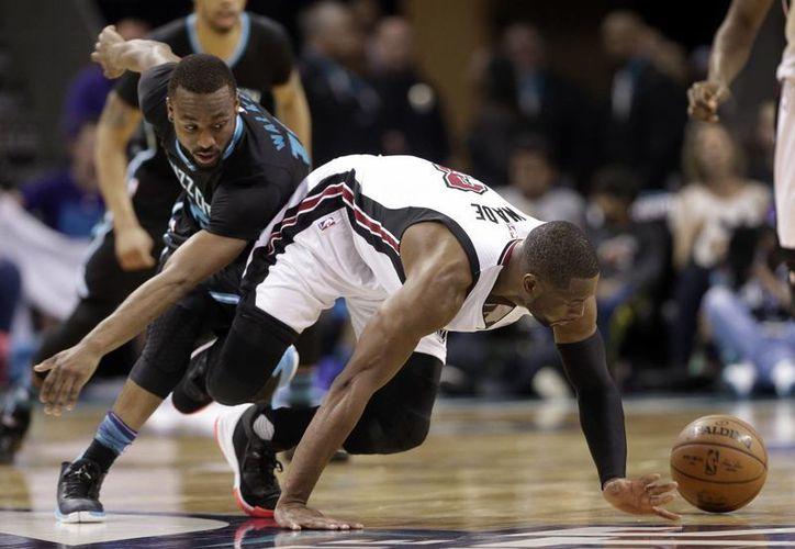 Luego de 14 años de no ganar en playoffs, los Hornets de Charlotte vencieron este sábado a Miami, en el duelo tres de la serie. (AP)