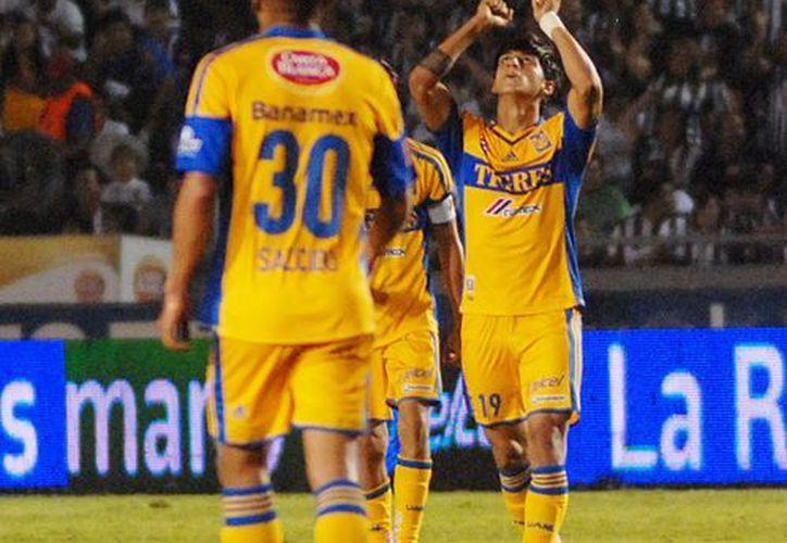 El 19 se enfrenta Tigres con el Atlas a las 19:00 horas en el estadio Universitario. (Notimex)