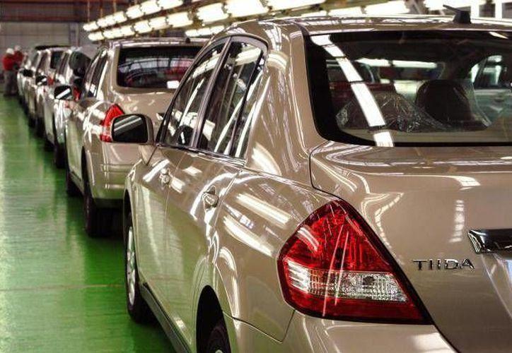 Los créditos para comprar automóviles sufrirán cambios en caso de que el Banco de México decida aumentar sus tasas de interés de referencia. (Archivo/SIPSE)