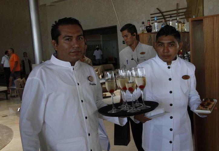 La mayoría de las empresas que pagan utilidades más altas son las cadenas hoteleras. (Tomás Álvarez/SIPSE)