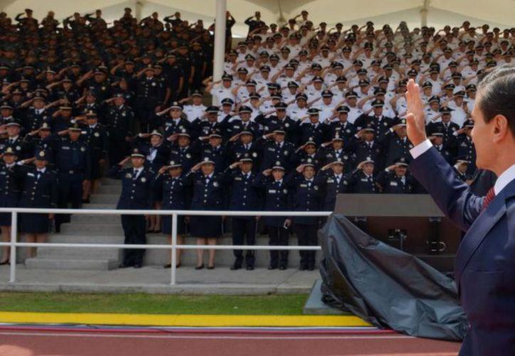 Peña Nieto expresó su reconocimiento a los 40 mil elementos de la Policía Federal, que cumple 88 años de existencia. (Presidencia)