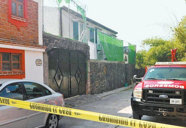 Domicilio cateado ayer para buscar más restos humanos, en Morelos. (David Monroy/Milenio)