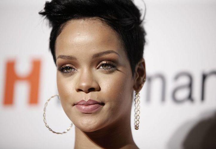 Rihanna ganó un juicio en Inglaterra por abuso comercial. Esta es una foto de archivo de la cantante correspondiente a febrero de 2009, durante la fiesta previa a la entrega de los premios Grammy. (AP)
